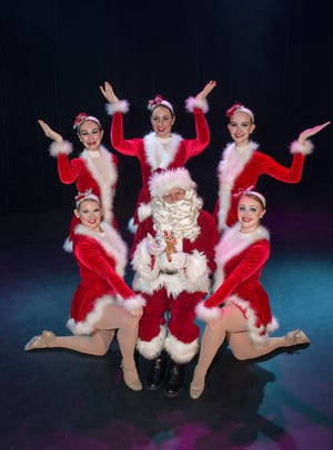 """Santa Claus (Cal  Hunter) is surrounded by fellow """"Cascade Christmas"""" performers. The 14th annual edition of the holiday tradition opens Friday at the Cascade Theatre."""