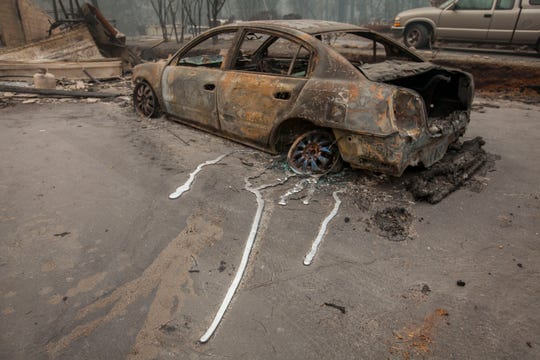 Melted metal is all that remains on a car in a neighborhood near Pentz Road in Paradise, CA, after the Camp Fire devastated the area.