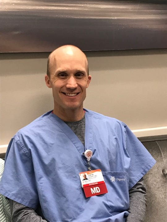 Neonatologist Justin Sharp sits in his office on his fifth day at work at Mercy Medical Center Redding back in October. Sharp moved to Redding shortly after the Carr Fire, drawn to the community because of Bethel Church as well as the professional opportunity.