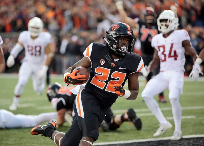 In this Oct. 6, 2018, file photo, Oregon State running back Jermar Jefferson (22) scores a touchdown during an NCAA college football in Corvallis, Ore. One of the few upsides in Oregon State's season has been the debut of freshman running back Jermar Jefferson.