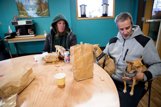 Raelynne Butler and her husband Paul Butler eat lunch at the ARCHES Project with their two dogs on Friday, Nov. 16, 2018, in Salem.