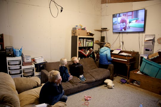 Four of the Tubbs family's seven children, Talon, 8, Tiana, 4, Teancum 6, and Tathena, 12, watch TV and play the piano in their temporary playroom on Thursday, Nov. 15, 2018, in Jefferson. The family purchased the property last year and found it was contaminated with meth.
