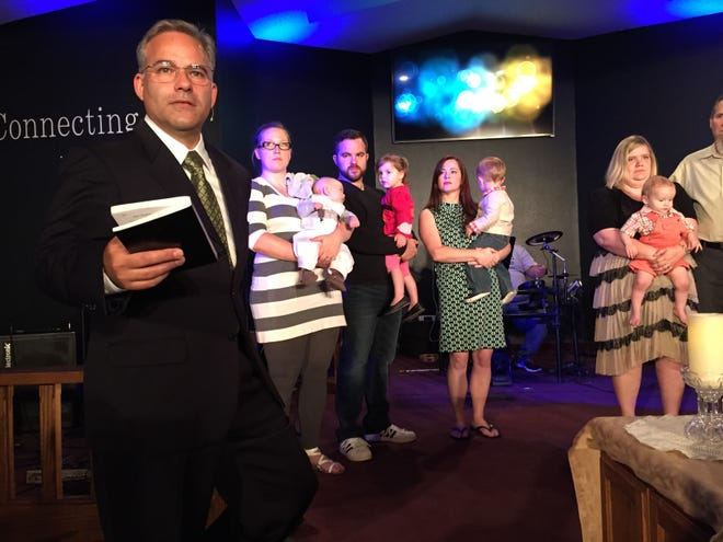 Pastor Dominic Carlow at a recent baby dedication at Silverton Church of the Nazarene.