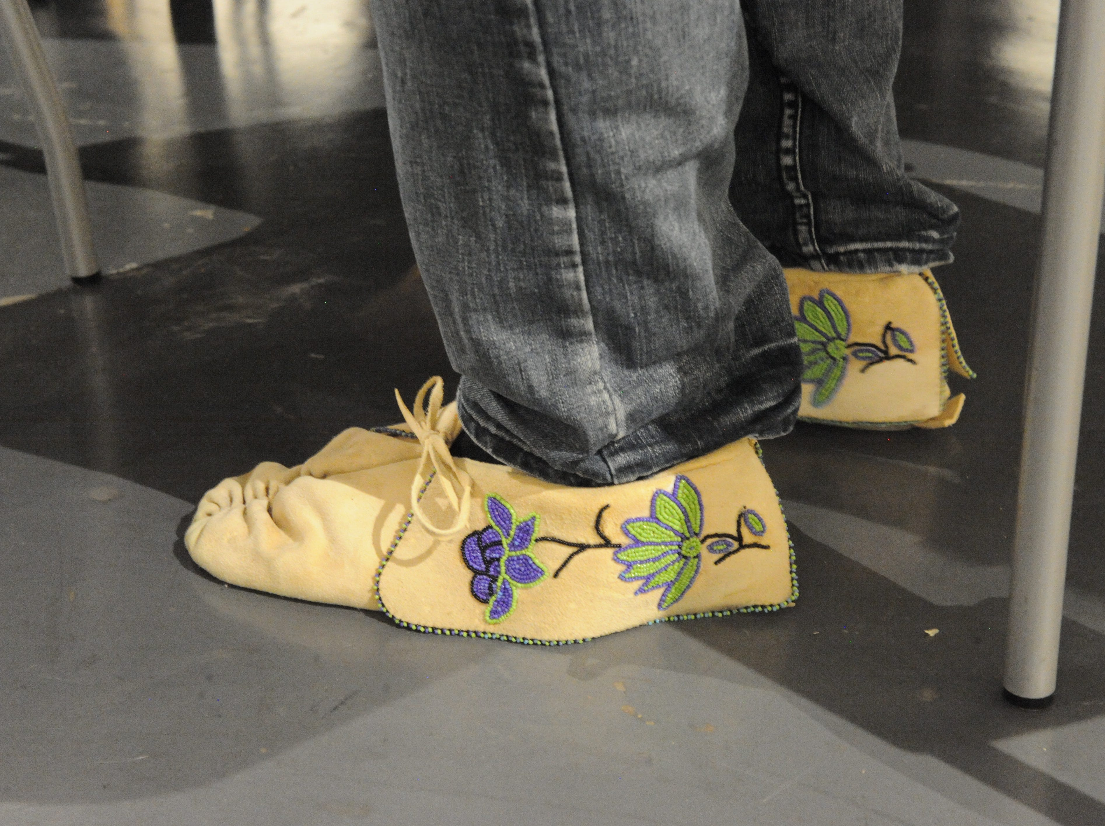 Browning Neddeau's pucker-toe moccasins, with designs of Haskell purple and lime green on the fold.
