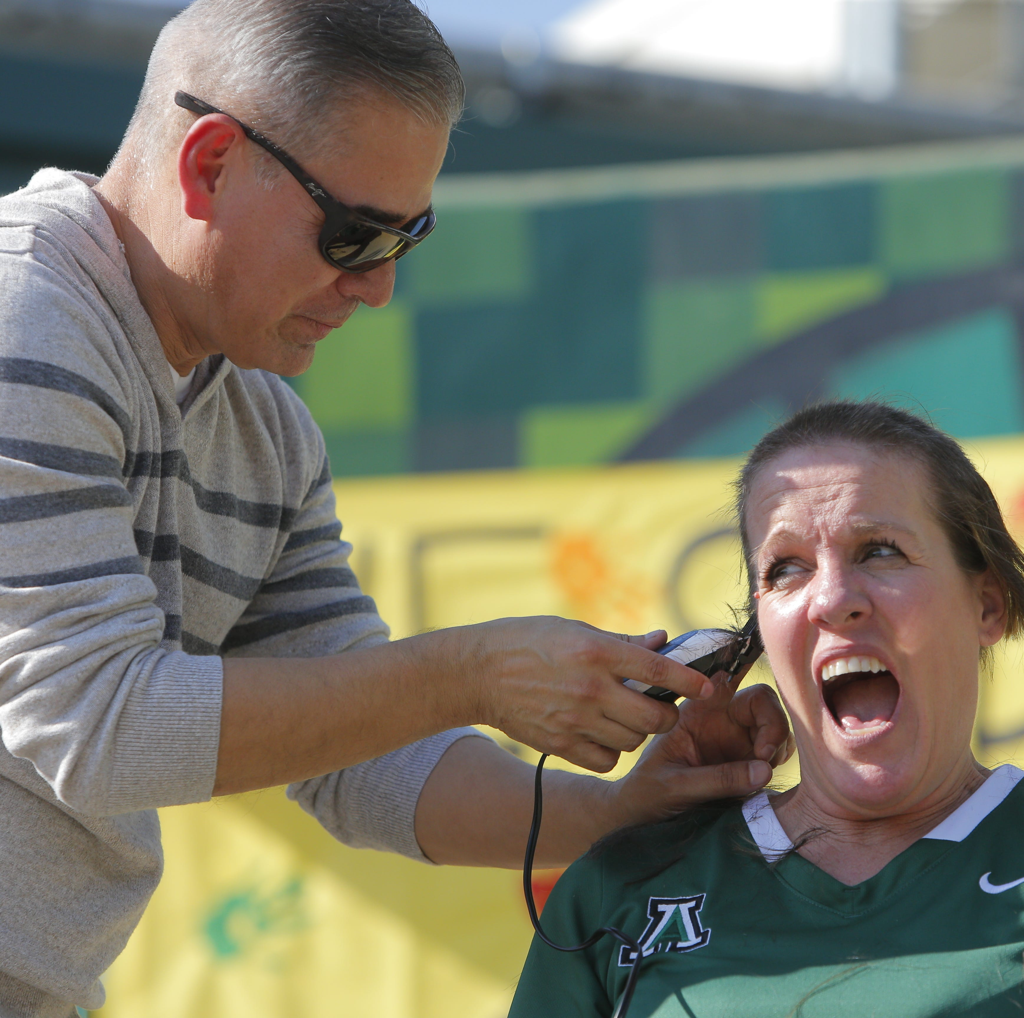 Alisal High teacher shaves head after losing a bet...all in the name of a good cause
