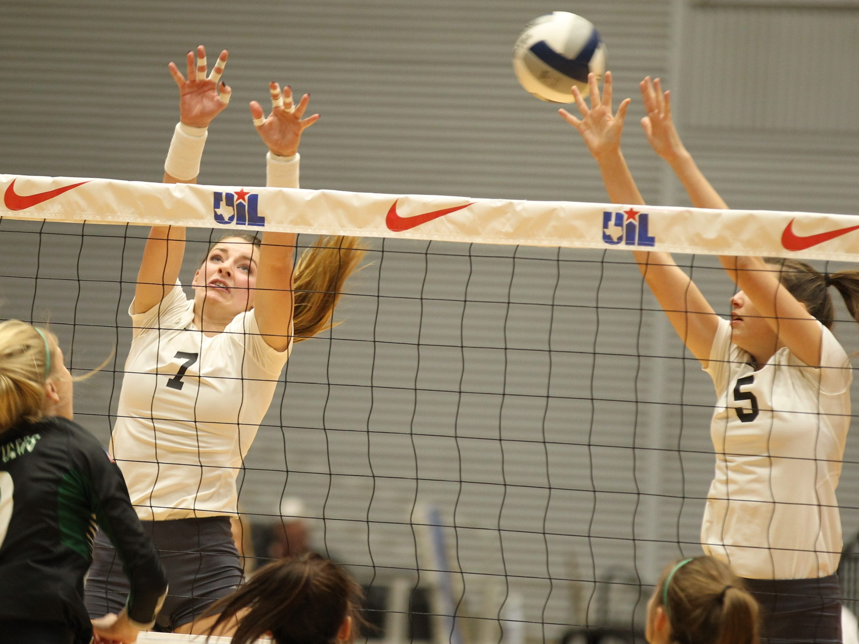 Water Valley High School's Kenzie Jordan (7) and Baily Dawson look to block a shot during the UIL Class 1A state volleyball championship match against Neches at the Curtis Culwell Center in Garland on Thursday, Nov. 15, 2018.