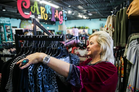 Vicki Housley organizes a display Nov. 2, 2018, at Carriage, 3029 Knickerbocker Road.