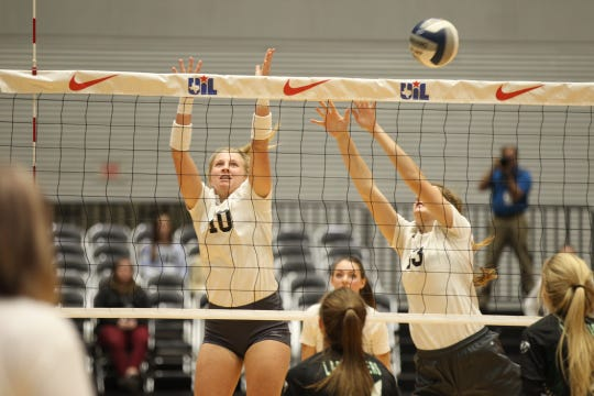 Water Valley High School's Chesney Baker (10) and Kendra Hoover go up for a block during the UIL Class 1A state volleyball championship match against Neches at the Curtis Culwell Center in Garland on Thursday, Nov. 15, 2018.