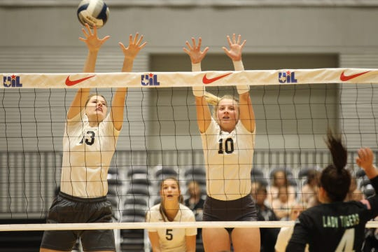 Water Valley High School's Kendra Hoover (13) and Chesney Baker go up for a block during the UIL Class 1A state volleyball championship match against Neches at the Curtis Culwell Center in Garland on Thursday, Nov. 15, 2018.