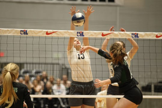 Water Valley High School's Kendra Hoover tries to make a block during the UIL Class 1A state volleyball championship match against Neches at the Curtis Culwell Center in Garland on Thursday, Nov. 15, 2018.
