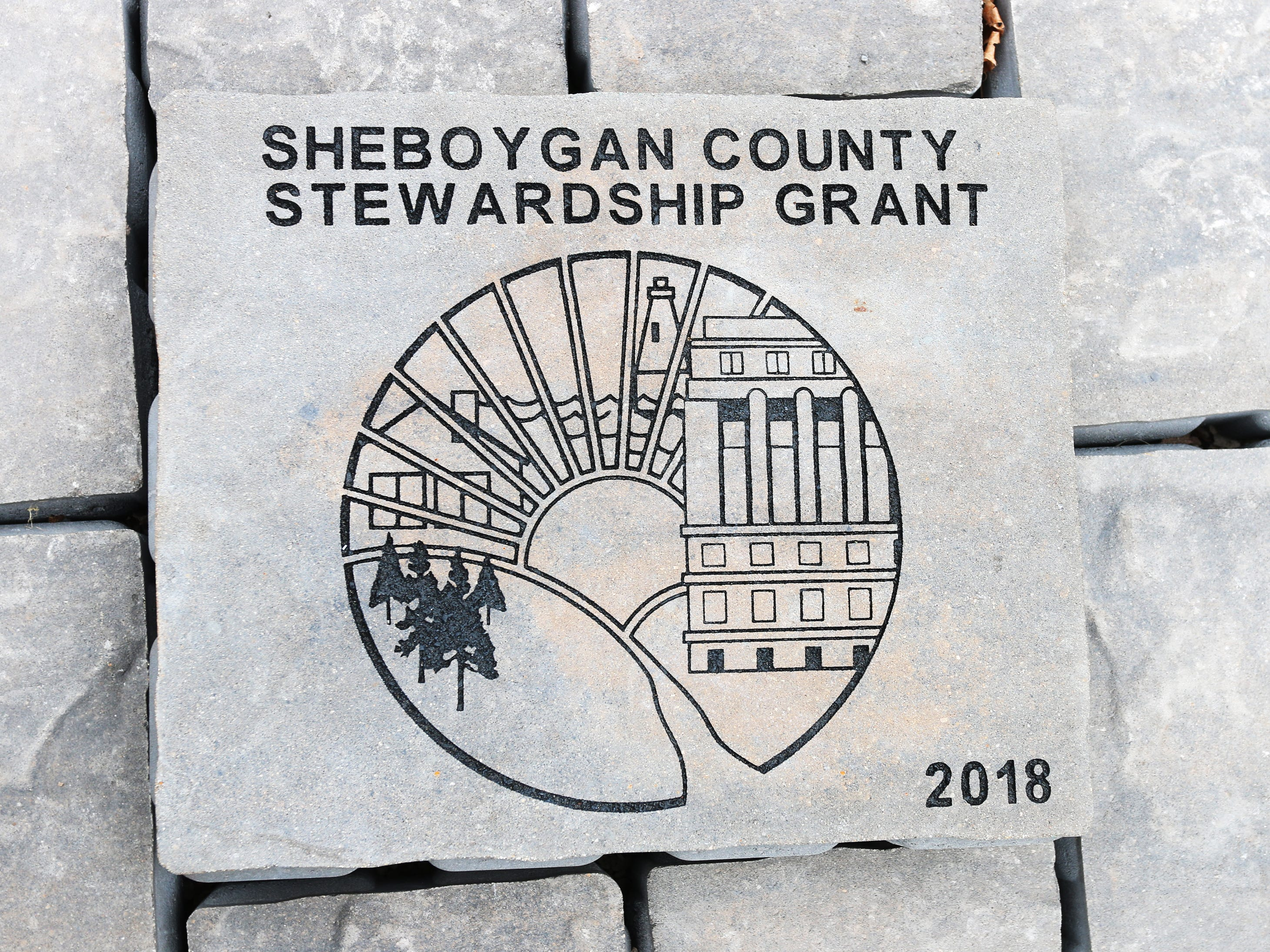 An engraved paver brick before installation during renovations at Sheboygan Peace Park, Friday, November 16, 2018, in Sheboygan, Wis. For more information go to: https://sheboyganpeacepark.org/