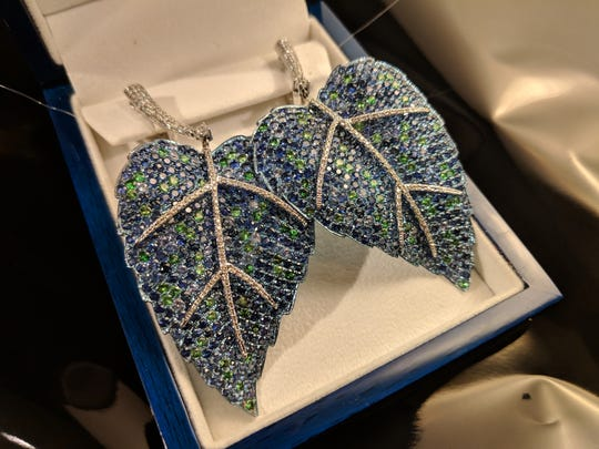 Sapphire and diamond leaf earrings set in 18K white gold by Sid Potts, available in the Christmas in the Sky live auction.