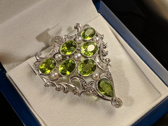 The Christmas in the Sky silent auction includes a peridot diamond pearl brooch crafted by Sid Potts.