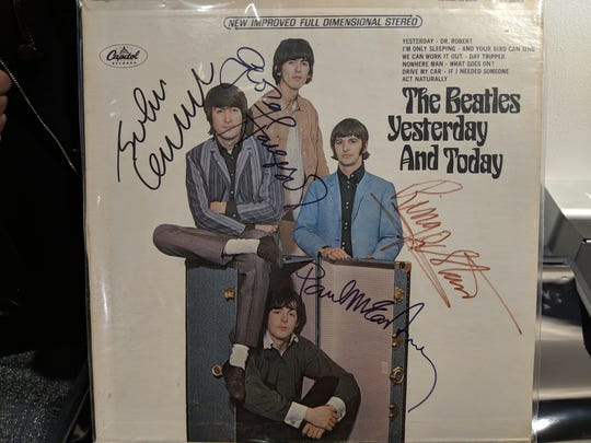 "A rare edition of The Beatles' ""Yesterday and Today"" album cover is available for bids in the Christmas in the Sky live auction."