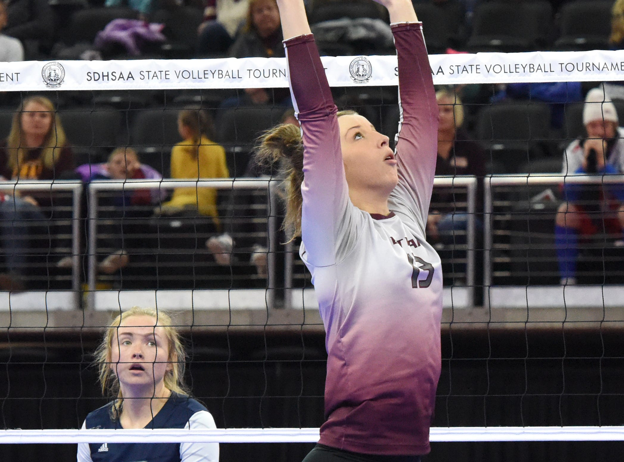 Ethan's Karly Gustafson (13) sets the ball during a match against Burke, Friday, Nov. 16, 2018, at the Denny Sanford Premier Center in Sioux Falls, S.D.
