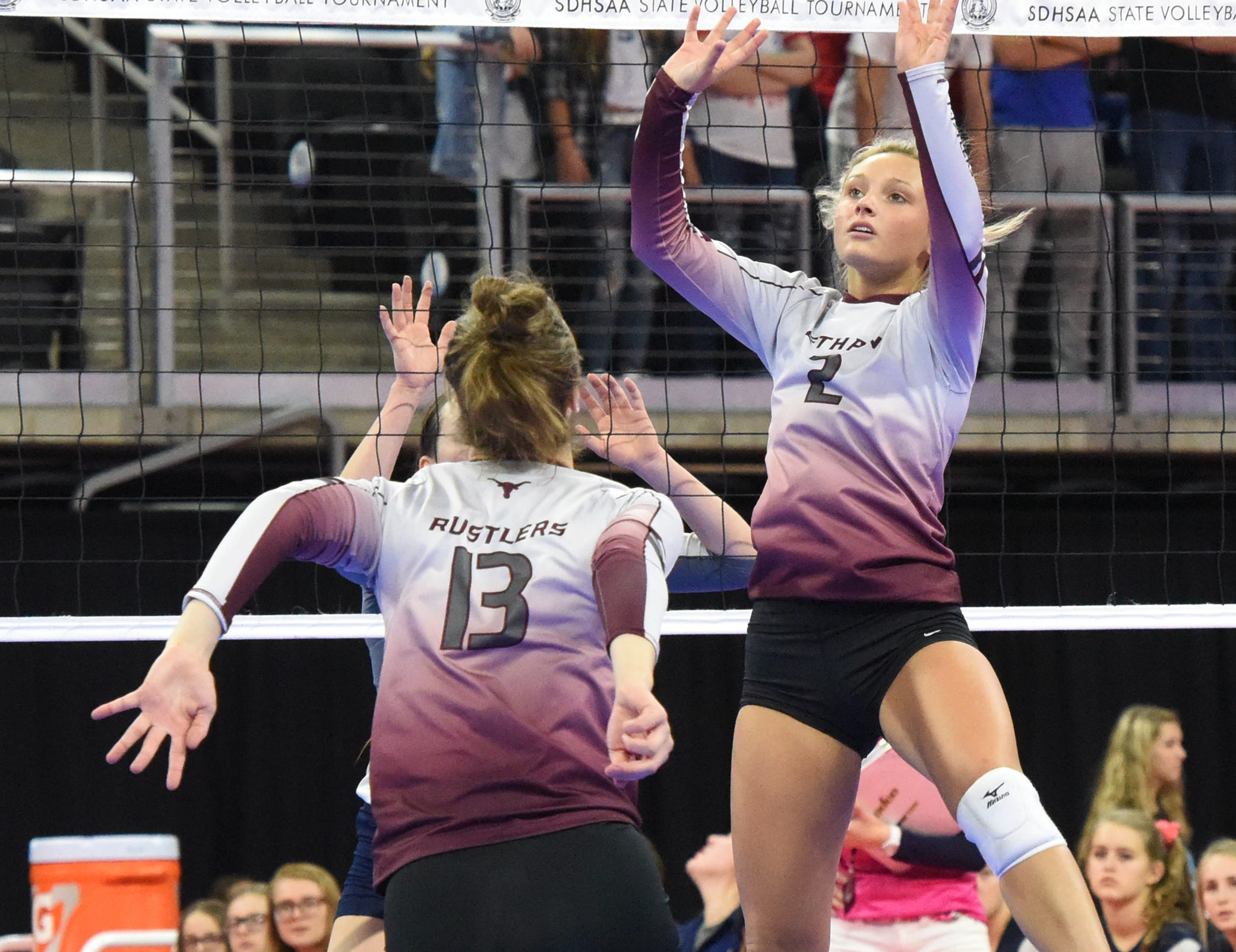 Ethan's Jessica Bartscher (2) sets the ball as Karly Gustafson (13) goes to spike it during a match against Burke, Friday, Nov. 16, 2018, at the Denny Sanford Premier Center in Sioux Falls, S.D.