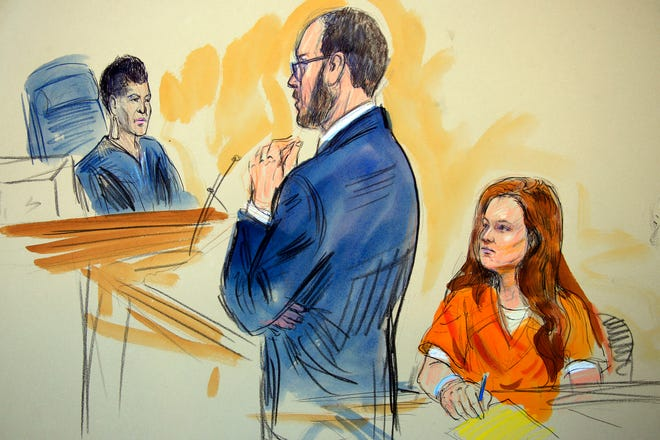 This July 18, 2018, file courtroom sketch depicts Maria Butina, listening to Assistant U.S. Attorney Erik Kenerson as he speaks to Judge Deborah Robinson, left, during a hearing in federal court in Washington.