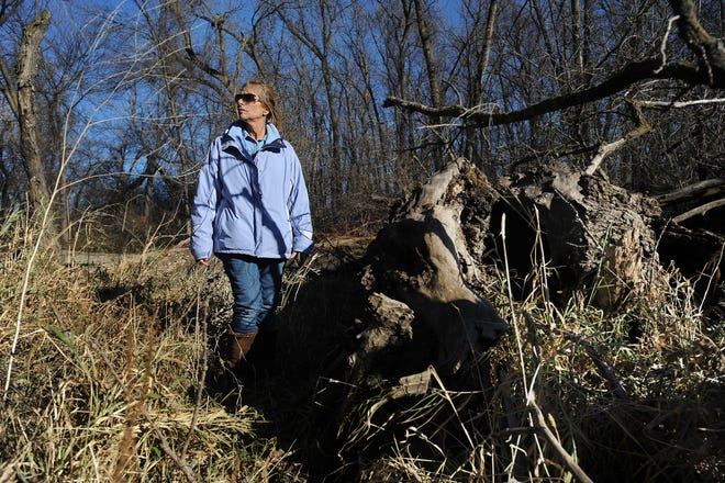 Sandra Cheskey revisits the site Wednesday, Nov. 13, 2013, where she and four friends were hanging out when the Fryer brothers began to shoot at them at Gitchie Manitou State Preserve near Granite, Iowa.