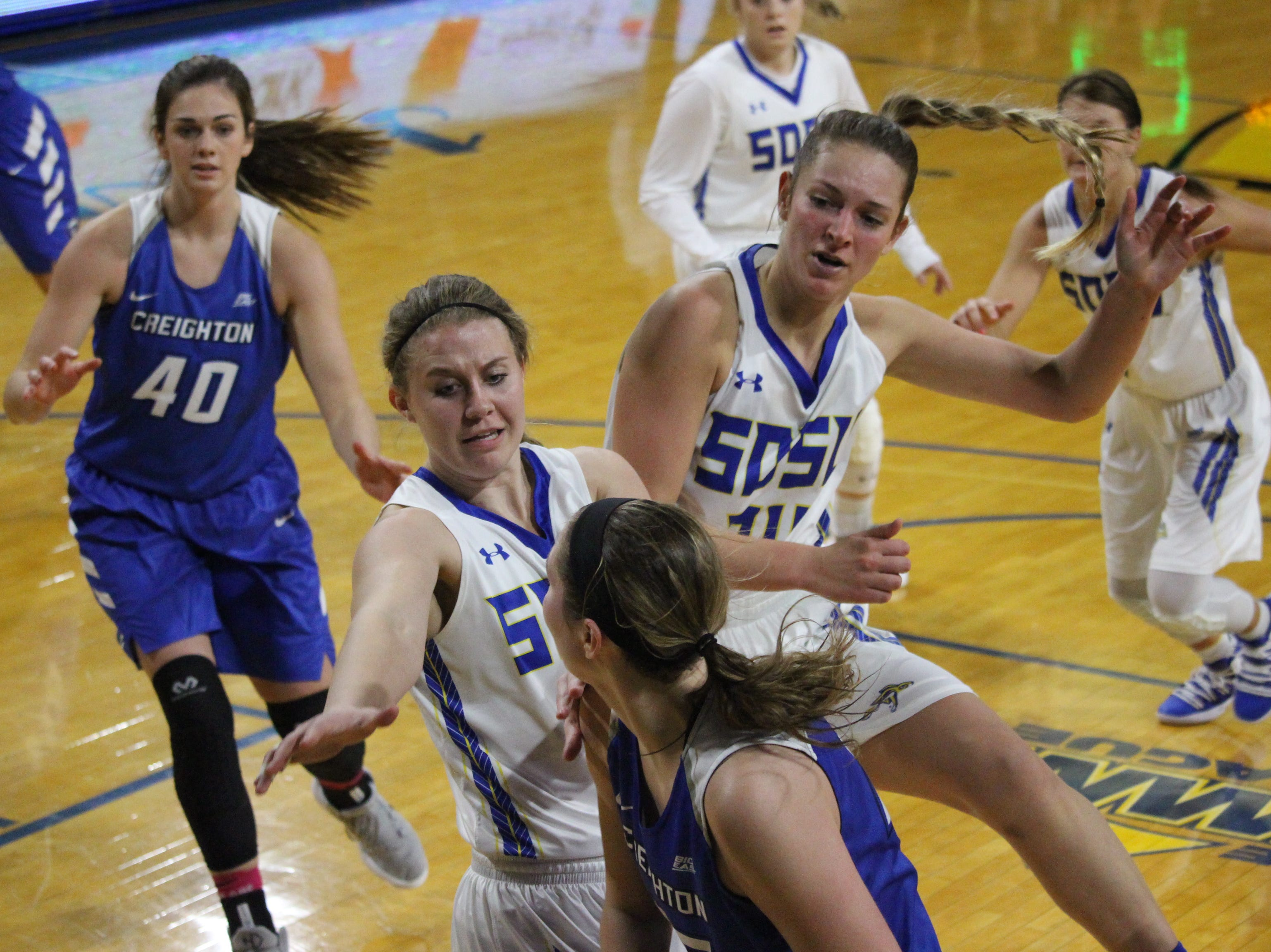 Myah Selland (L) and Tagyn Larson defend for SDSU during their win over Creighton Thursday night at Frost Arena