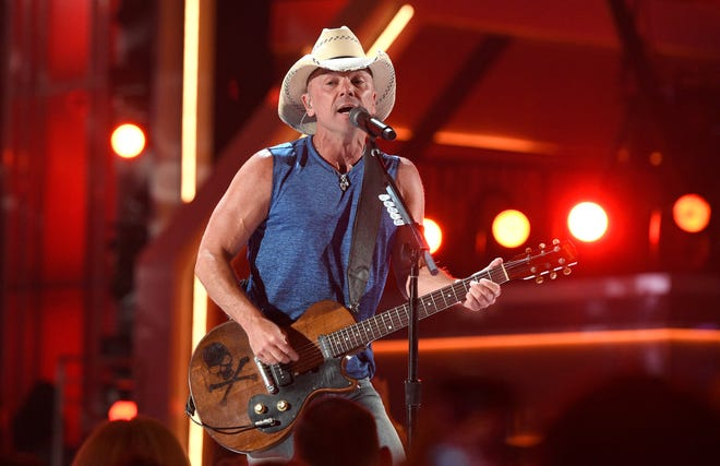"""Kenny Chesney performs """"Get Along"""" at the 53rd annual Academy of Country Music Awards at the MGM Grand Garden Arena on Sunday, April 15, 2018, in Las Vegas. (Photo by Chris Pizzello/Invision/AP)"""