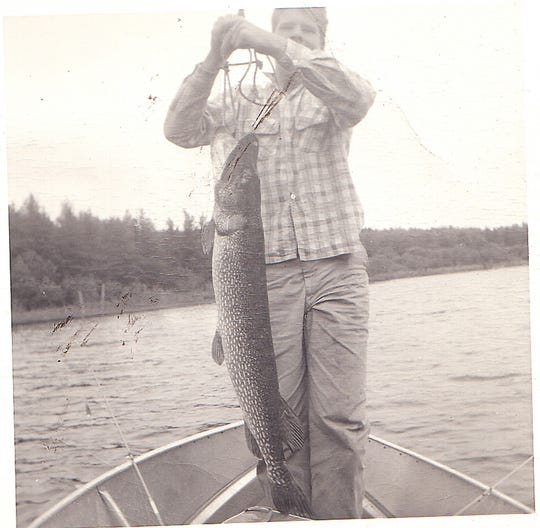 The author at 15, with a 30-pound Quetico pike. He learned early that the adventure was worth it.