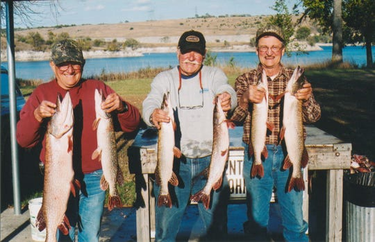 Friends Bob Podzimek, Jerry Hnetynka, and Curt Kaberna with Missouri River pike.
