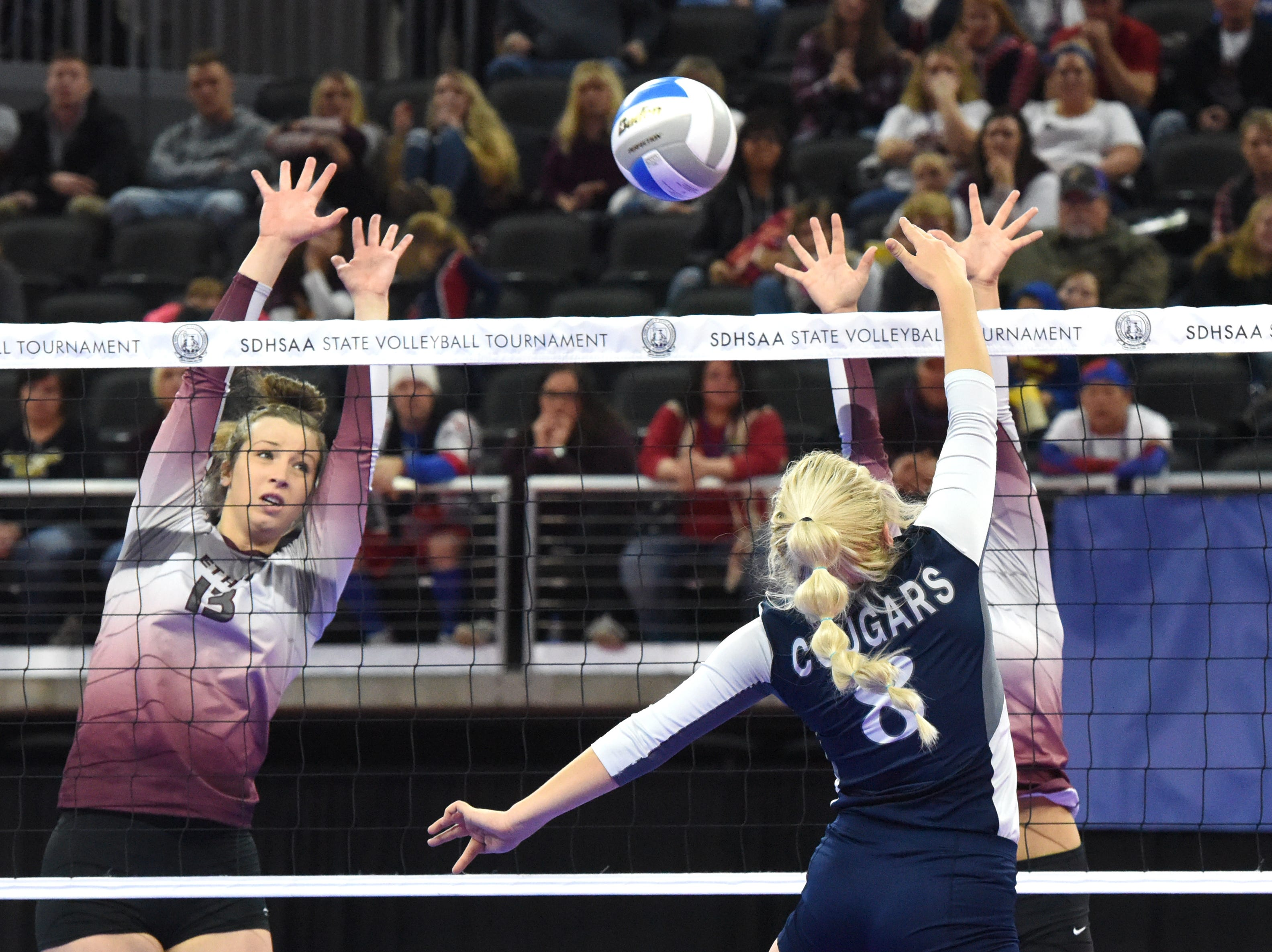 Ethan players try to block the ball during a match against Burke, Friday, Nov. 16, 2018, at the Denny Sanford Premier Center in Sioux Falls, S.D.