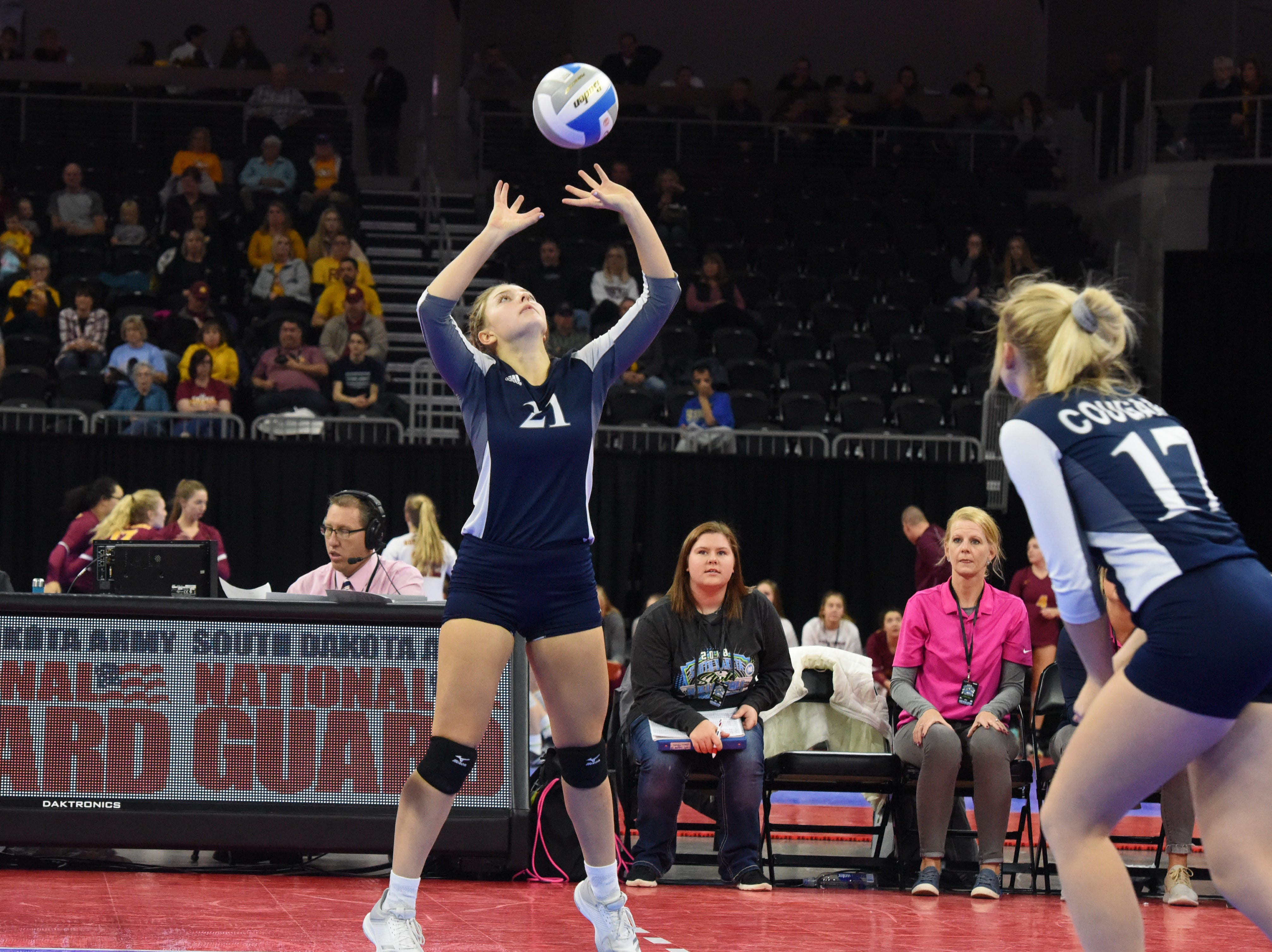 Burke's Sally Hakin (21) sets the ball during a match against Ethan, Friday, Nov. 16, 2018, at the Denny Sanford Premier Center in Sioux Falls, S.D.