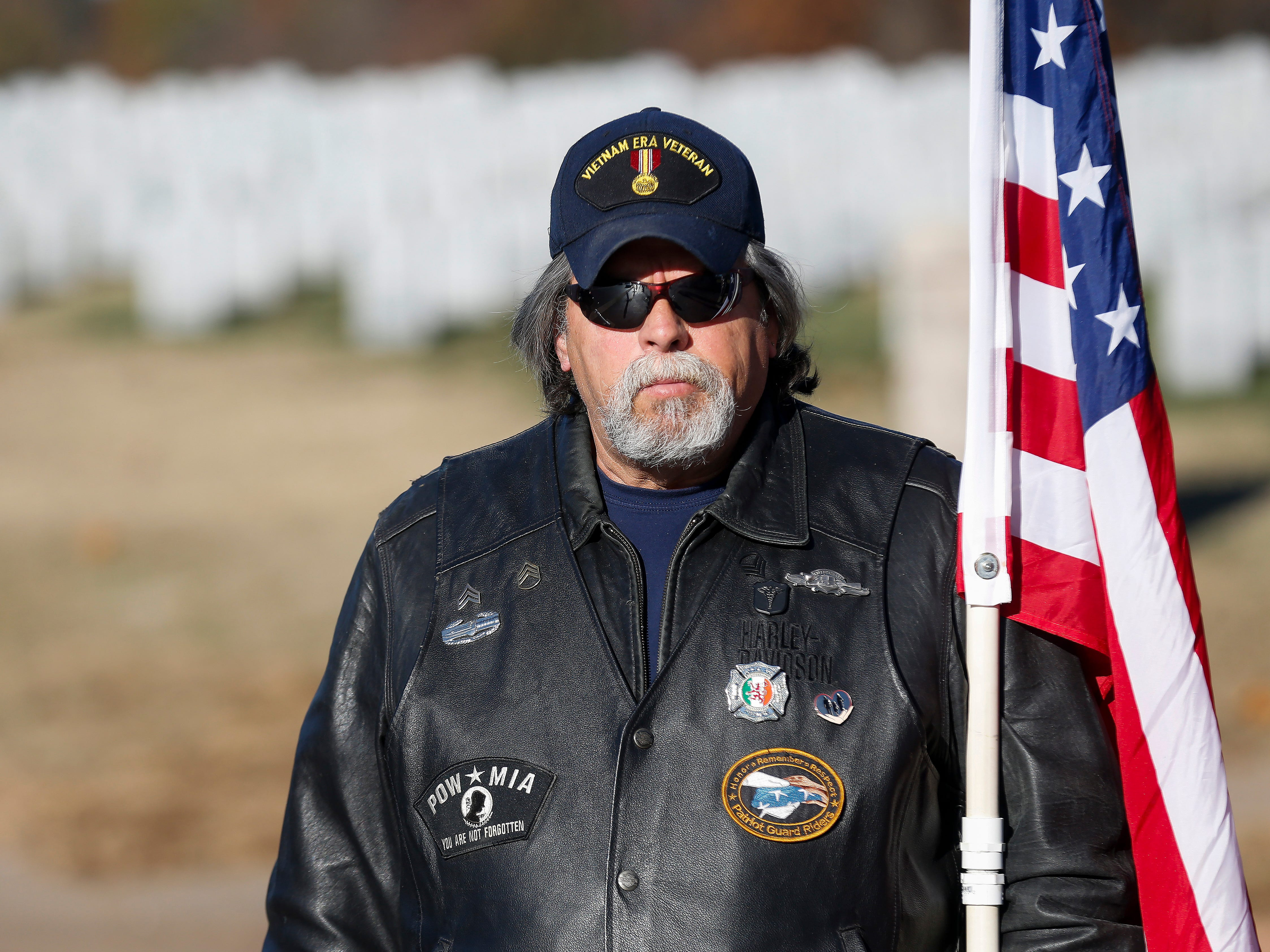 Paul McGuire, a member of the Patriot Guard Riders, stands outside of the chapel during the funeral of Army veteran Michael Hiers at the Missouri Veterans Cemetery on Friday, Nov. 16, 2018.