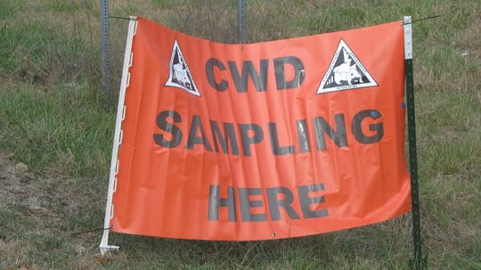 A sign pointing the way to a CWD checkpoint.