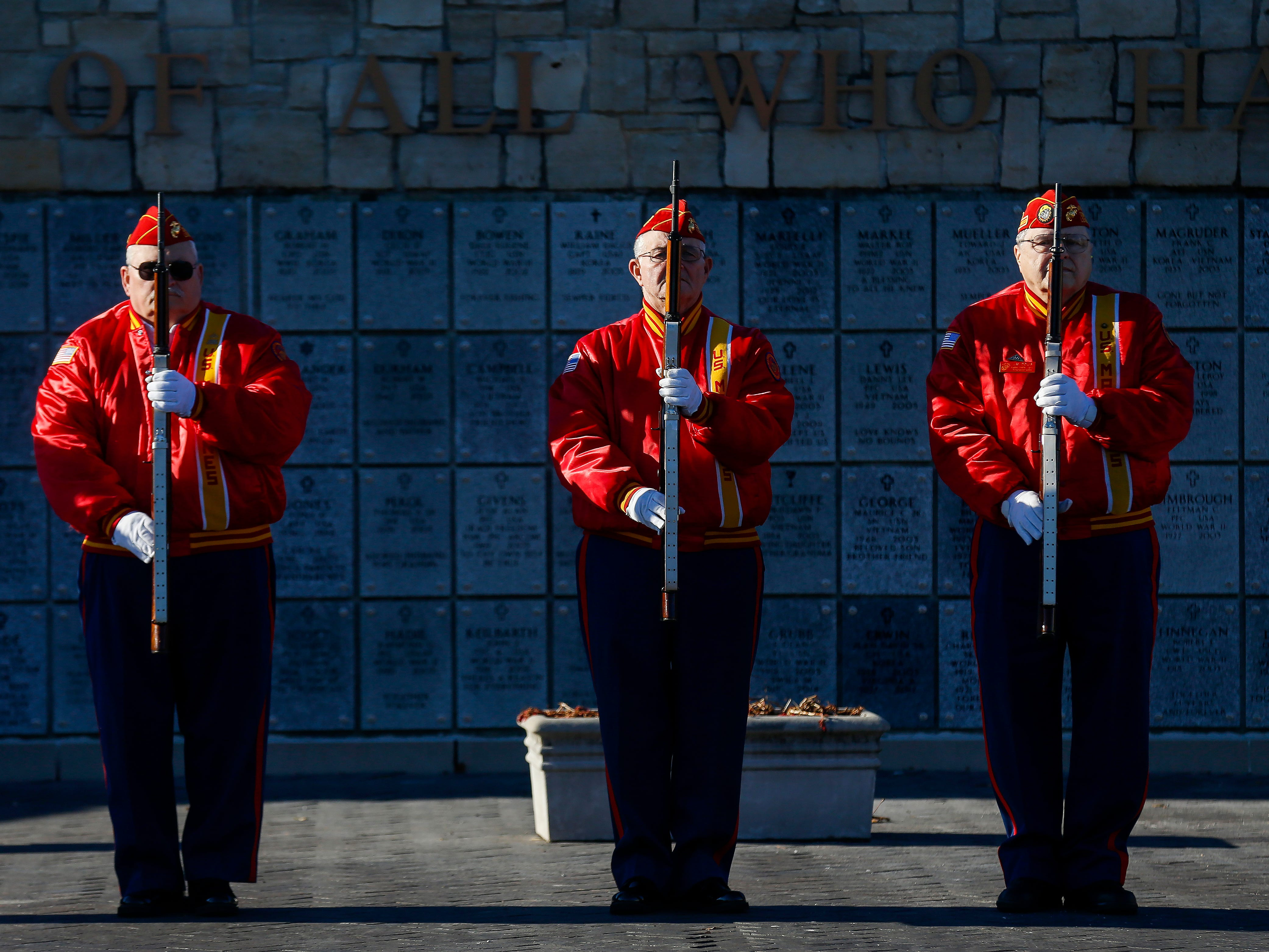 Members of the Marine Corps Memorial Team stand at attention during the funeral of Army veteran Michael Hiers at the Missouri Veterans Cemetery on Friday, Nov. 16, 2018.