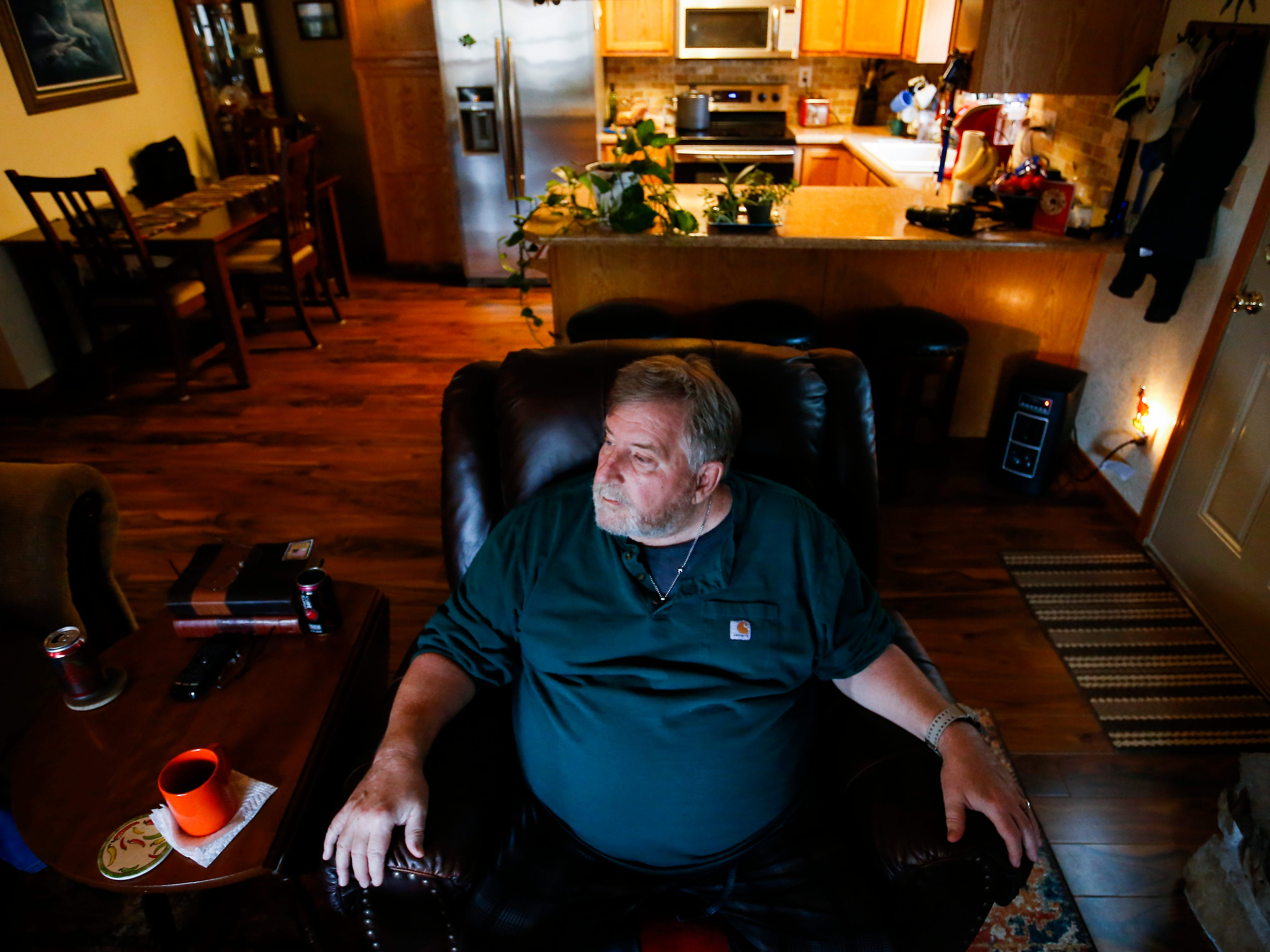 "Scott Morgan sits back in his chair at his Branson West home on Wednesday, Nov. 14, 2018. Morgan said he feels trapped in a ""prison"" by incurable, severe and daily pain."