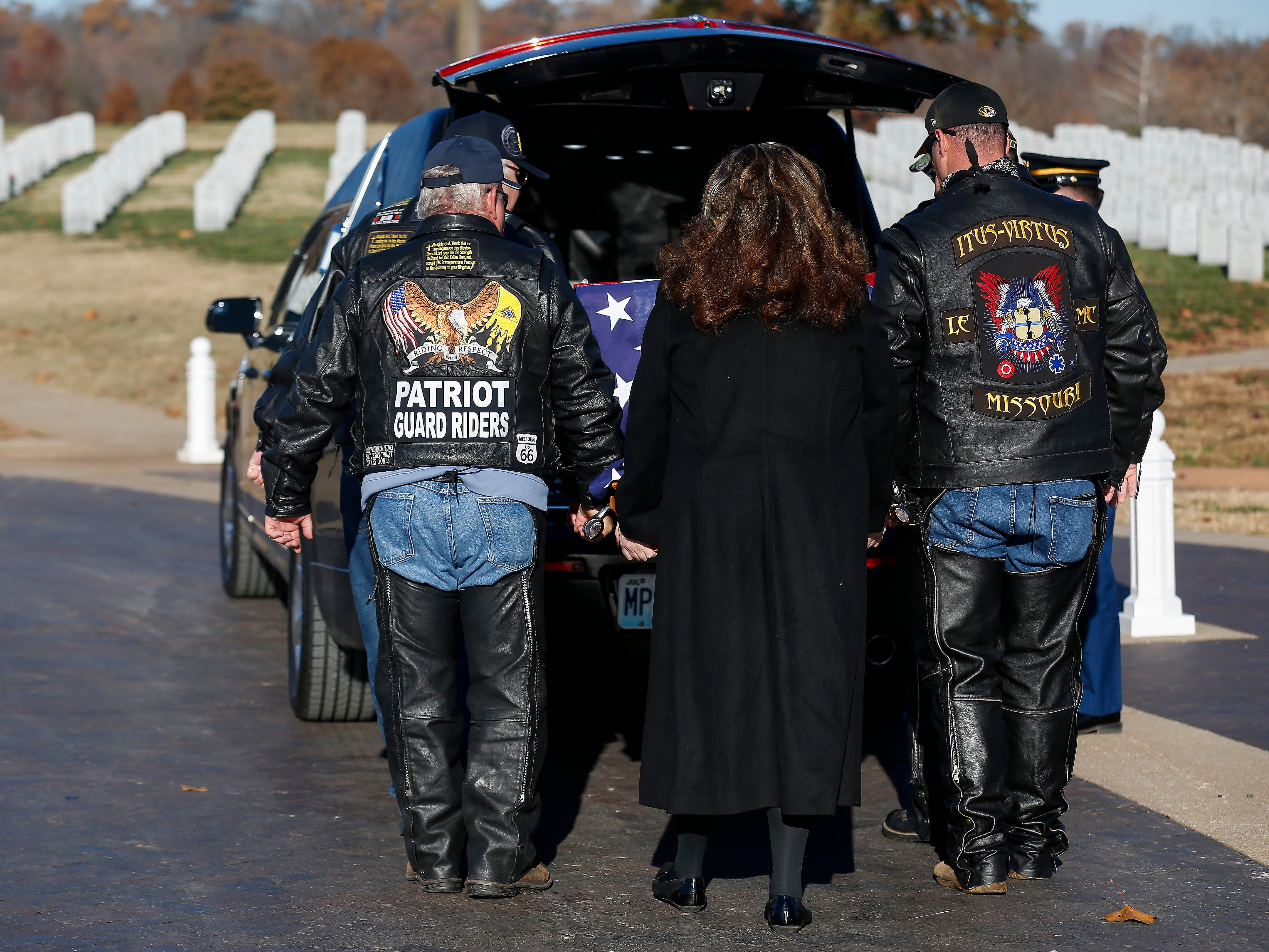 Members of the Patriot Guard Riders serve as pallbearers during the funeral of Army veteran Michael Hiers at the Missouri Veterans Cemetery on Friday, Nov. 16, 2018.