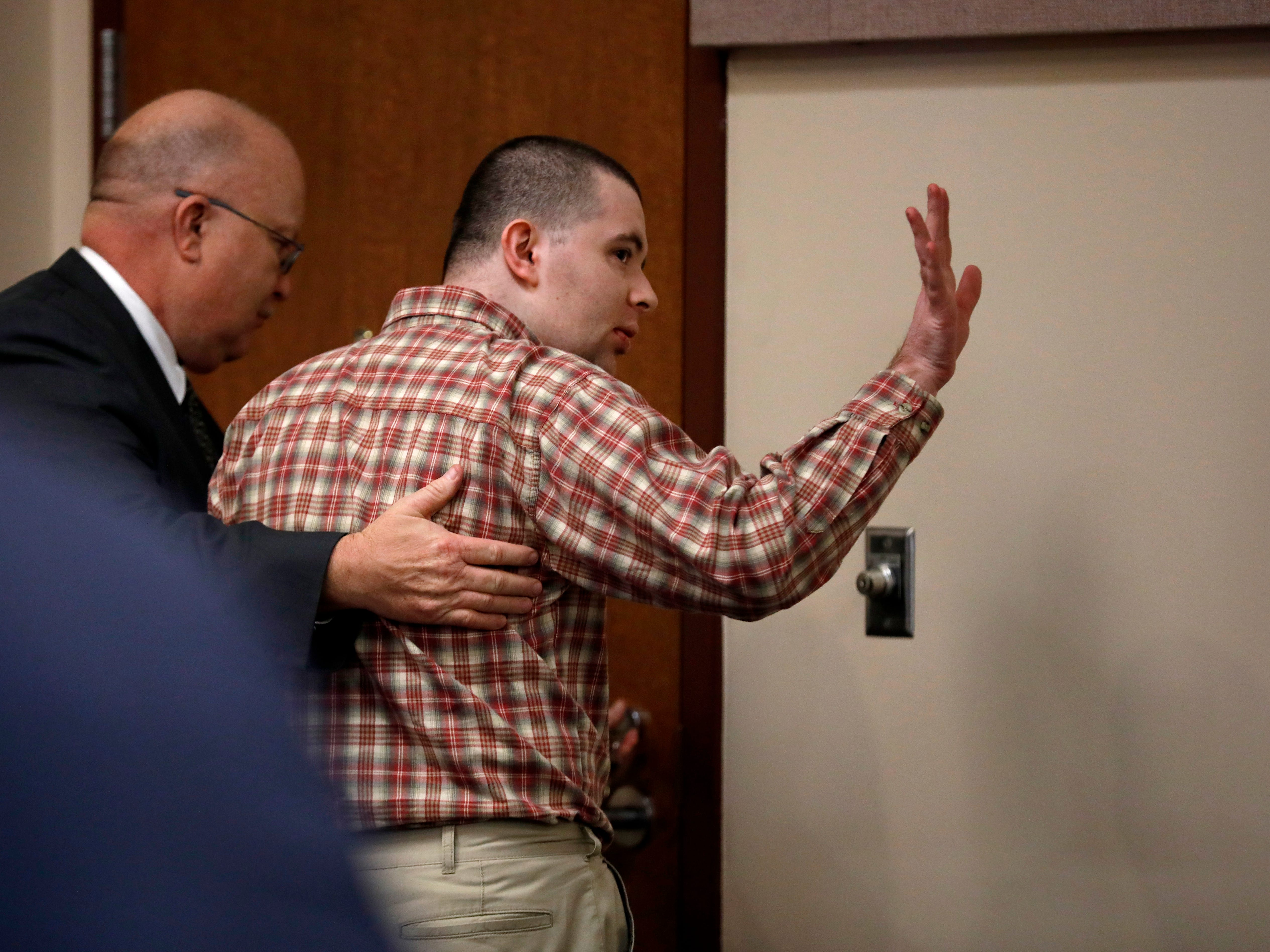 "Nicholas Godejohn waves to his dad after being found guilty of murder in the first degree for the June 2015 murder of Clauddine ""Dee Dee"" Blanchard."