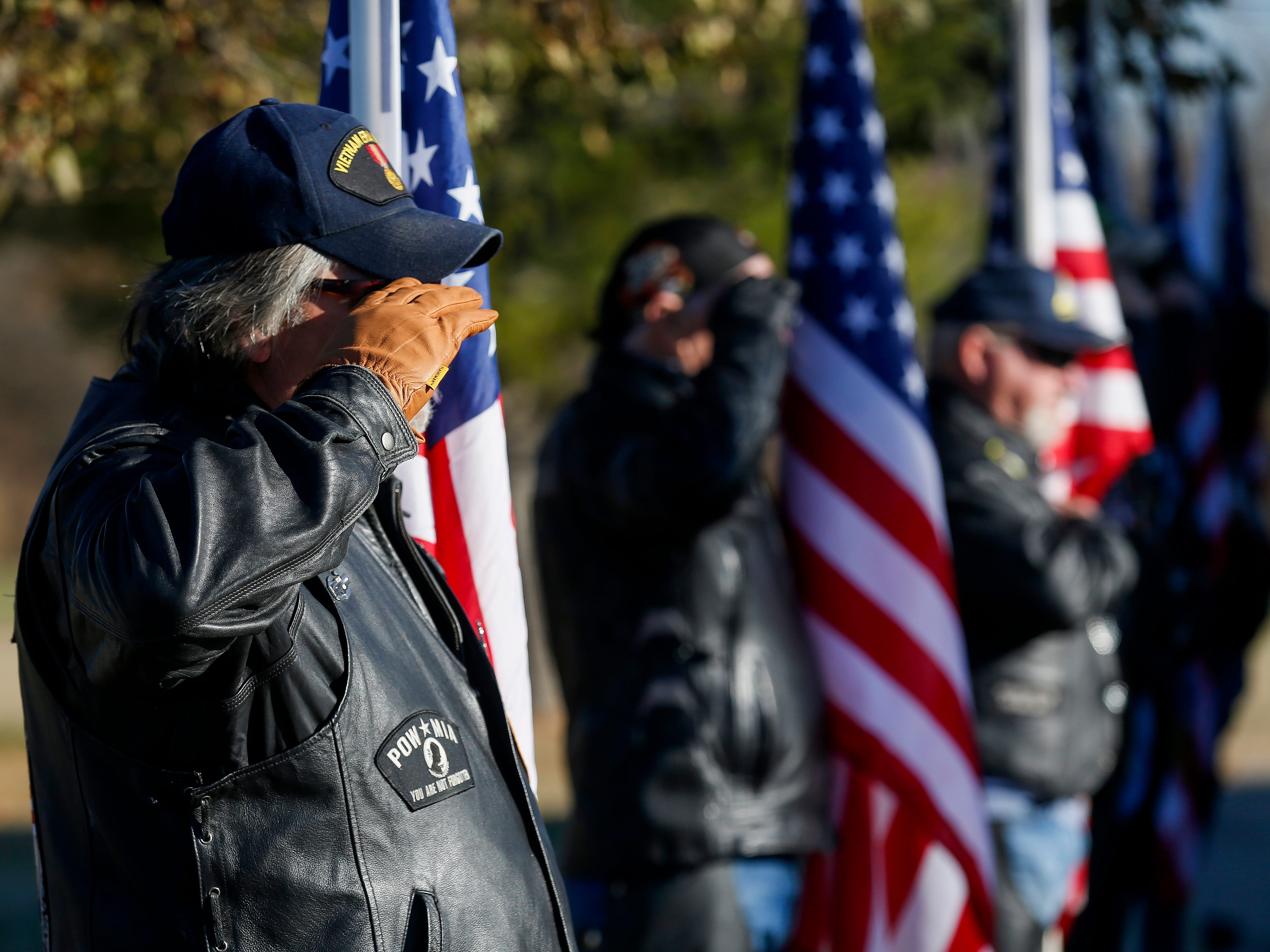 Paul McGuire, left, a member of the Patriot Guard Riders, renders a salute during the funeral of Army veteran Michael Hiers at the Missouri Veterans Cemetery on Friday, Nov. 16, 2018.