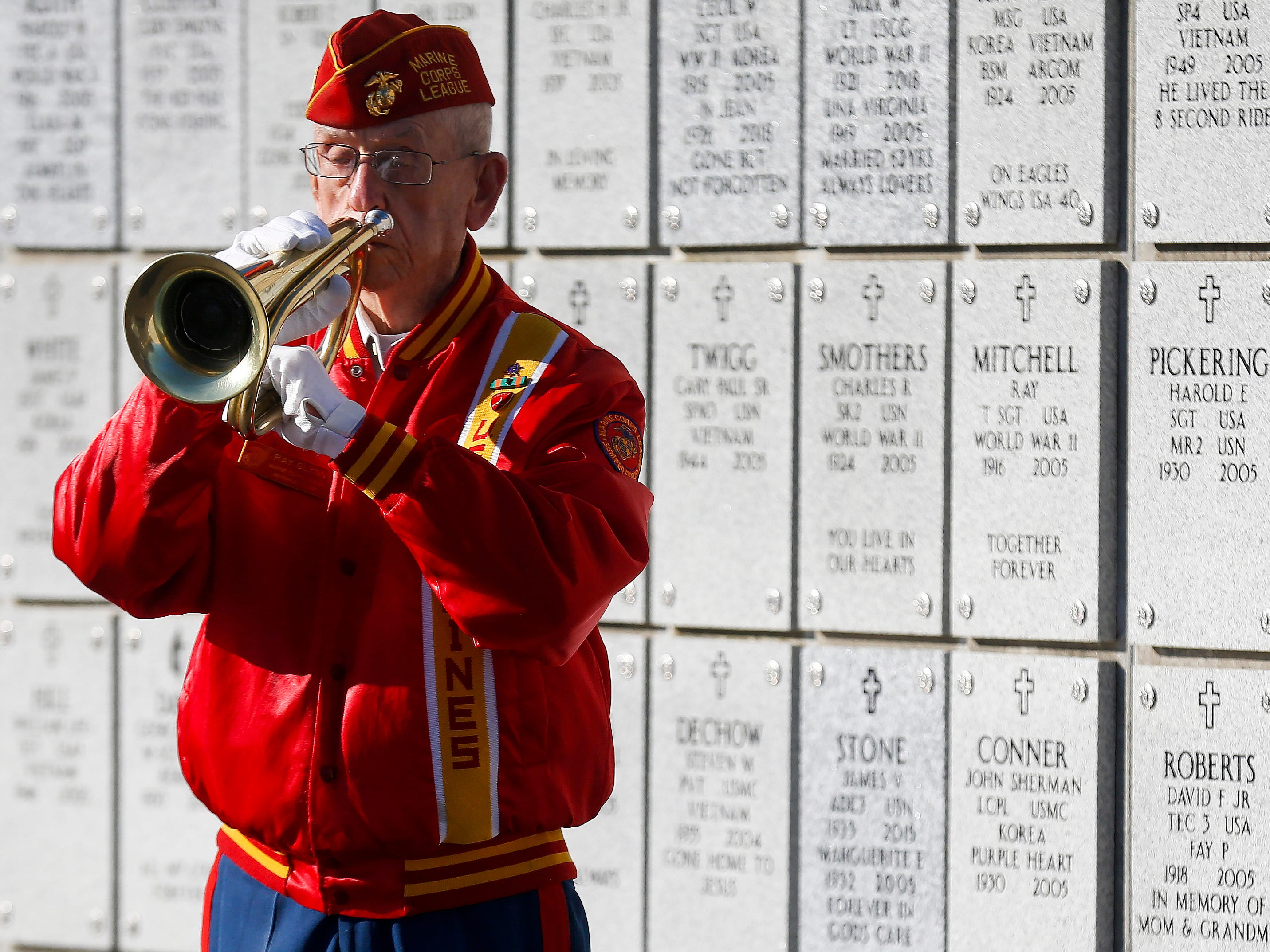 Ray Glynn, a member of the Marine Corps Memorial Team, plays taps during the funeral of Army veteran Michael Hiers at the Missouri Veterans Cemetery on Friday, Nov. 16, 2018.