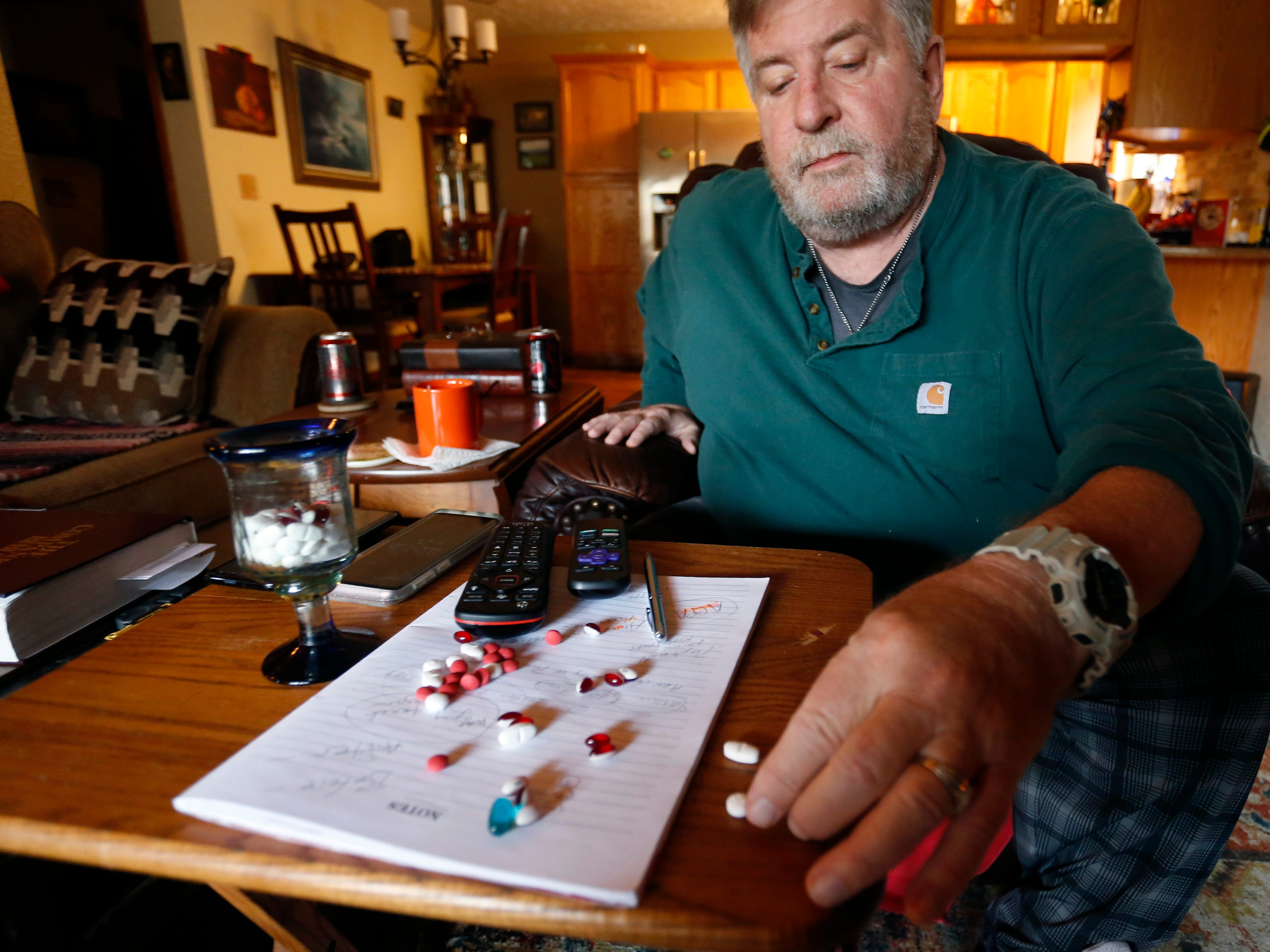 Scott Morgan shows the pills he uses to manage his intractable pain at his home in Branson West on Wednesday, Nov. 14, 2018. Morgan used to keep his pain at bay through powerful prescription opioids but because of the Department of Health and Human Services declared the national opioid crisis as a public health emergency he can no longer get the medicine at the strength and frequency he says he needs.