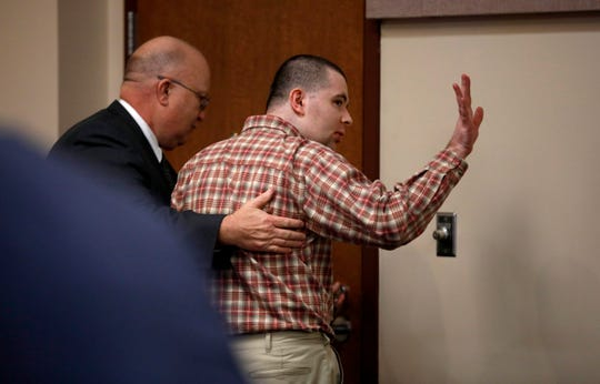 "Nicholas Godejohn waves to his dad after being found guilty of murder in the 1st degree for the June of 2015 murder of Clauddine ""Dee Dee"" Blanchard."