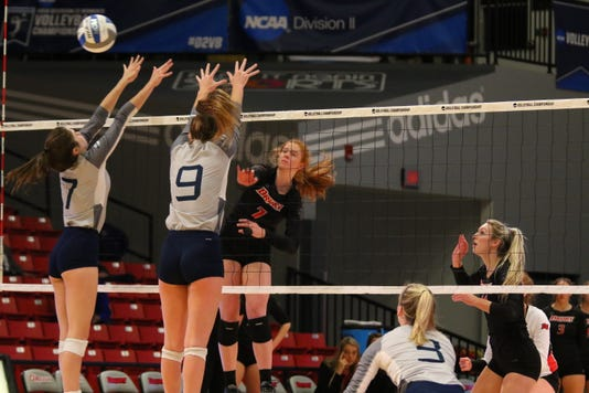 Fiery Drury pulls away to advance in regional volleyball