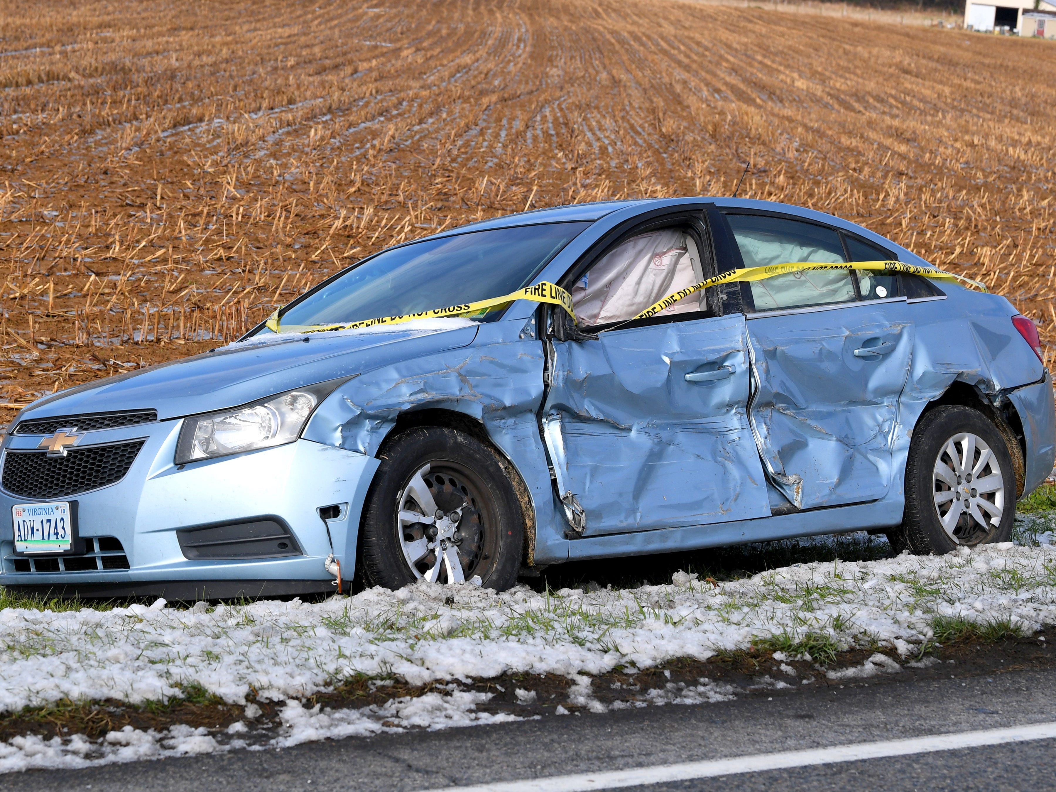 A car parked beside Tinkling Spring Road near Stuarts Draft shows damage along the driver's side following an ice storm Friday, Nov. 16, 2018.