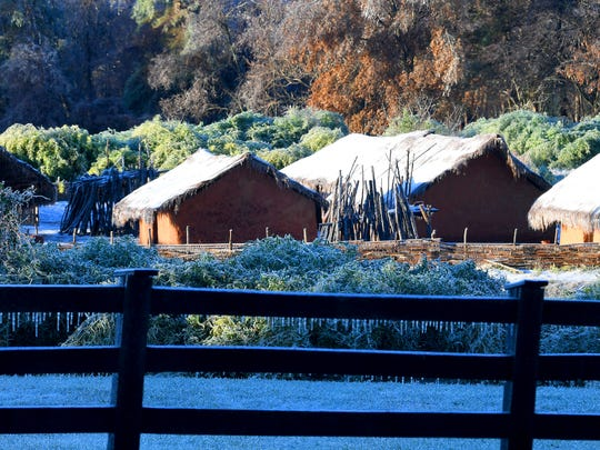 Ice covers the roofs of buildings on the African farm at the Frontier Culture Museum on an ice-covered Friday morning, Nov. 16, 2018.