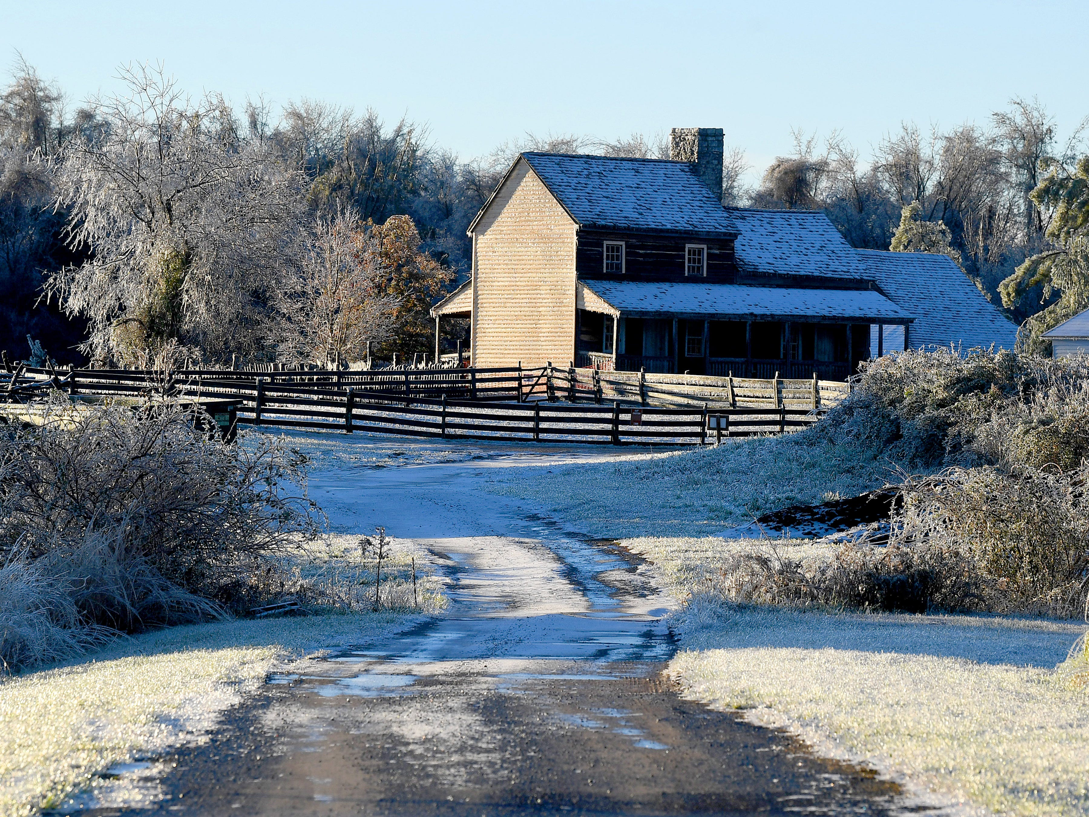 An icy scene along a road leading to the American farm at the Frontier Culture Museum on an ice-covered Friday morning, Nov. 16, 2018.