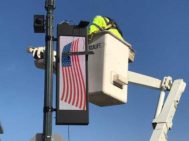 City of St. Cloud crews work Thursday on one of the LED light poles and video boards in downtown St. Cloud.