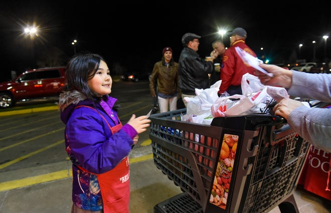 Sarah Parker hands out information to shoppers at Coborn's on Cooper Avenue during a kickoff event for this year's Salvation Army Red Kettle Drive Thursday, Nov. 15, in St. Cloud.