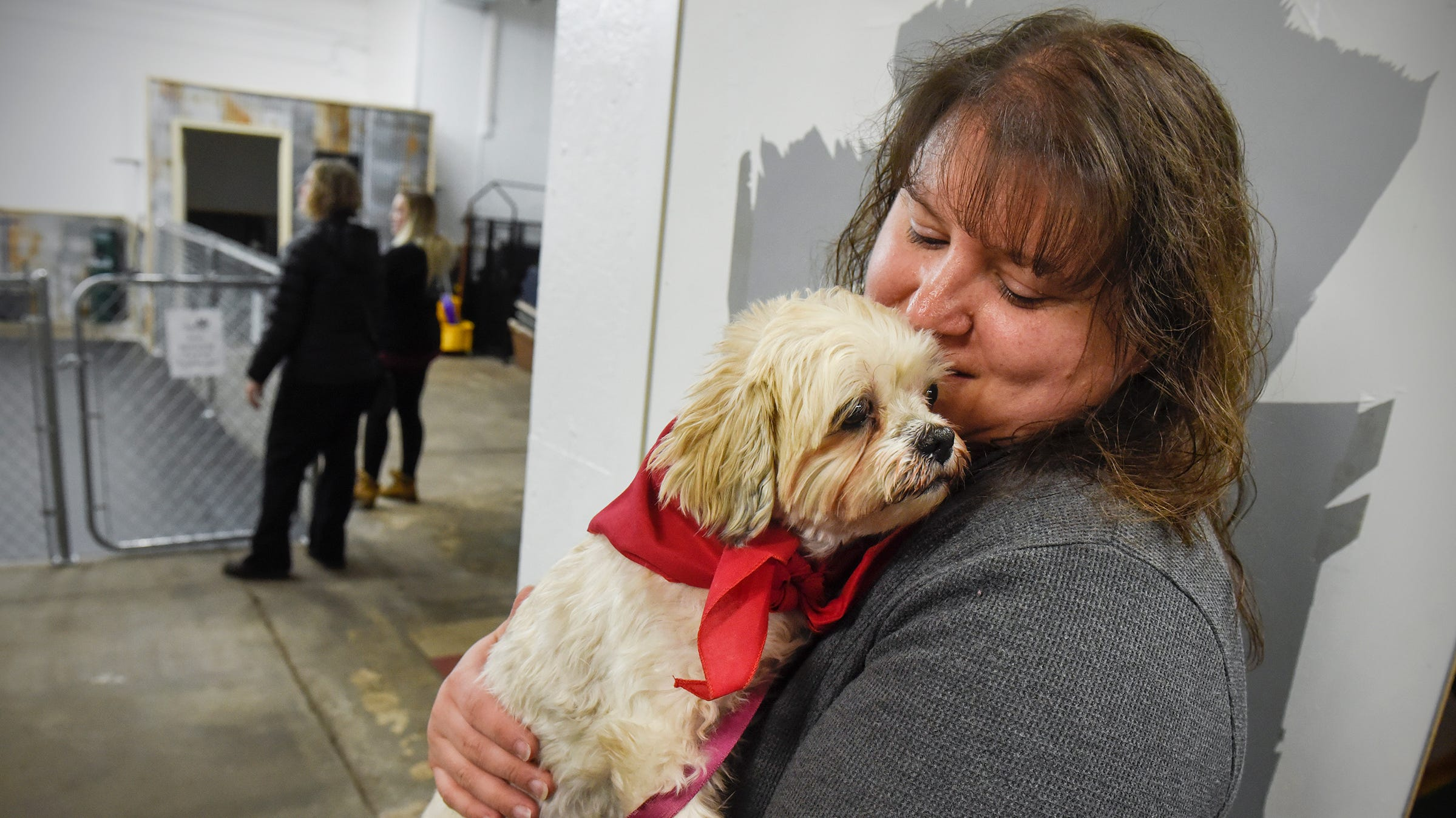 Pet foster Debbie Haus comforts senior dog Piper during an event at Grey Face Rescue Thursday, Nov. 15, in St. Cloud.