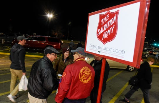 People gather for a seasonal kickoff event for this year's Salvation Army Kettle Drive Thursday, Nov. 15, in St. Cloud.
