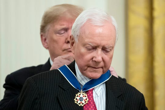 """President Donald Trump awards Sen. Orrin Hatch, R-Utah, the Medal of Freedom during a ceremony in the East Room of the White House in Washington, on Nov. 16, 2018. One of the longest-serving Republican senators in U.S. history, Hatch is retiring in January after more than 40 years. Trump called Hatch a """"great friend of mine"""" who """"liked me right from the beginning, and therefore I like him."""" Six others were awarded medals during the ceremony."""