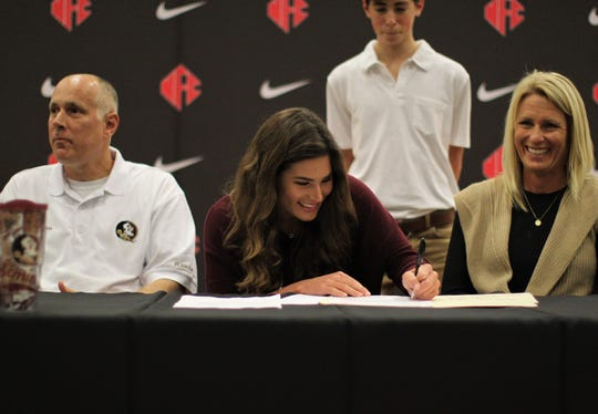 North Florida Christian senior softball player Chloe Culp signed with Florida State during a signing ceremony in the NFC gym on Wednesday, Nov. 14, 2018.