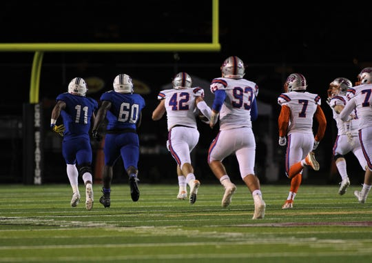 Bolles defensive tackle Simon Brackin takes off on a 72-yard fumble return touchdown during a 32-27 win over Godby in a Region 1-5A semifinal at Gene Cox Stadium on Thursday, Nov. 15, 2018.