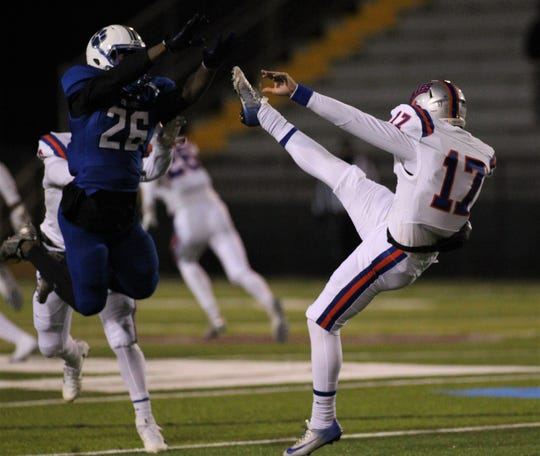 Godby senior Rajay Solomon flies in late on an attempted punt block of Bolles' Jack Brady, awarding a penalty, during a 32-27 loss to Bolles in a Region 1-5A semifinal at Gene Cox Stadium on Thursday, Nov. 15, 2018.